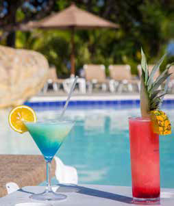 View of poolside with two drinks